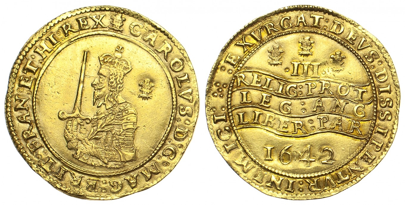 The front and back of two gold coins. The left coin (front) shows a man holding a sword, the right (back) has some text in Latin.