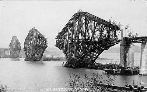 Black-and-white photo from the construction of the Forth Bridge.