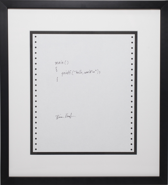 A hand-written and signed C program, mounted in a black frame.