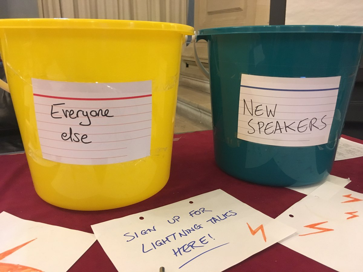 "A green bucket on the right labelled ""New speakers"", and a yellow bucket on the left labelled ""Everybody else""."