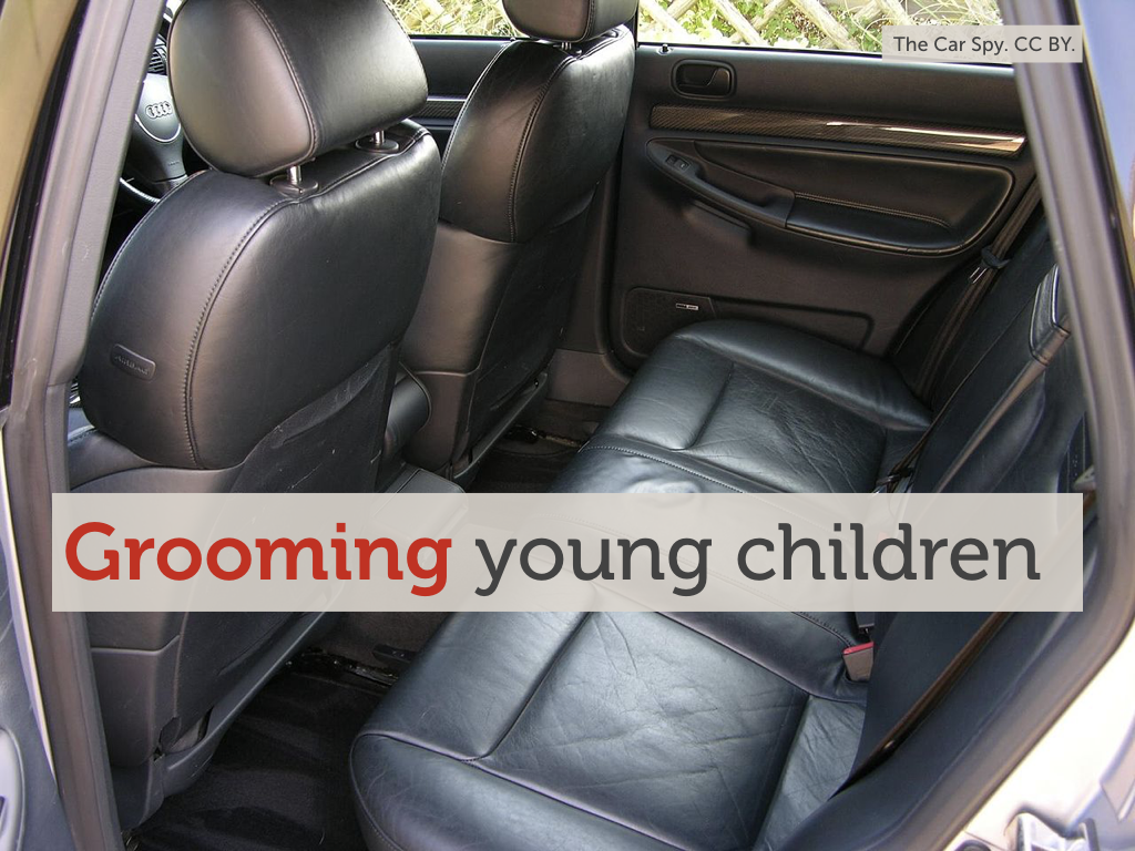 "A photo of the back seat of a car with the overlaid text ""Grooming young children""."
