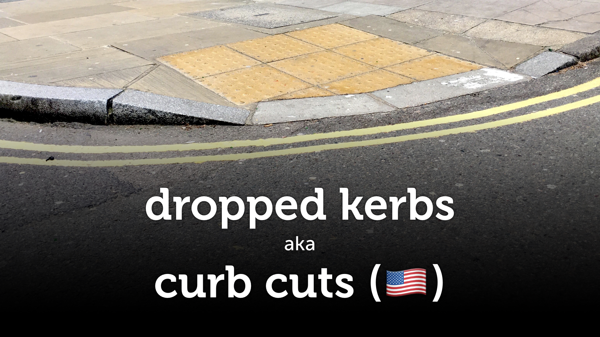 "A dropped kerb against a black background, with the caption ""dropped kerb aka curb cut""."