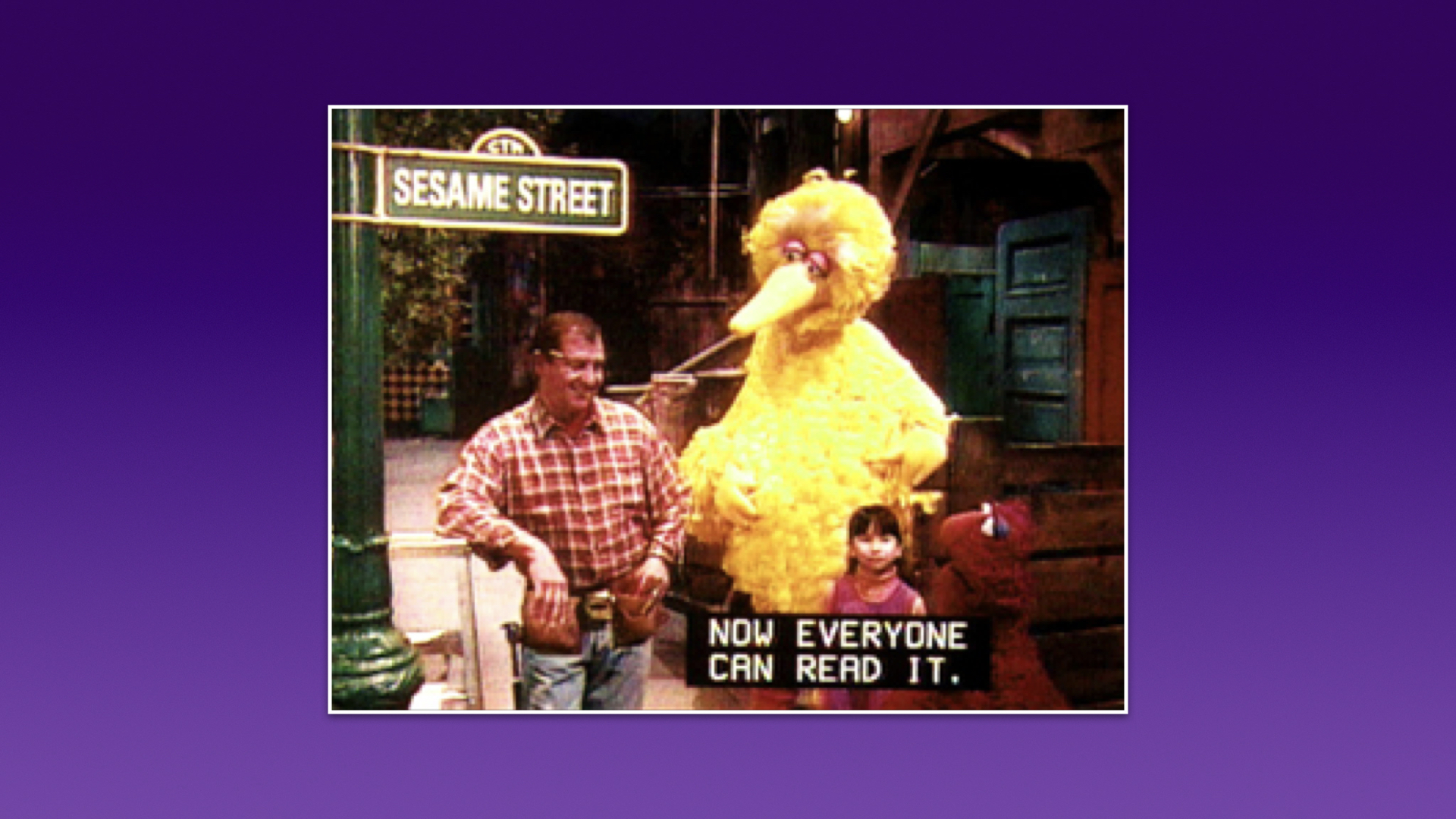 "A screenshot from Sesame Street, with four characters on screen and a caption ""Now everyone can read it""."