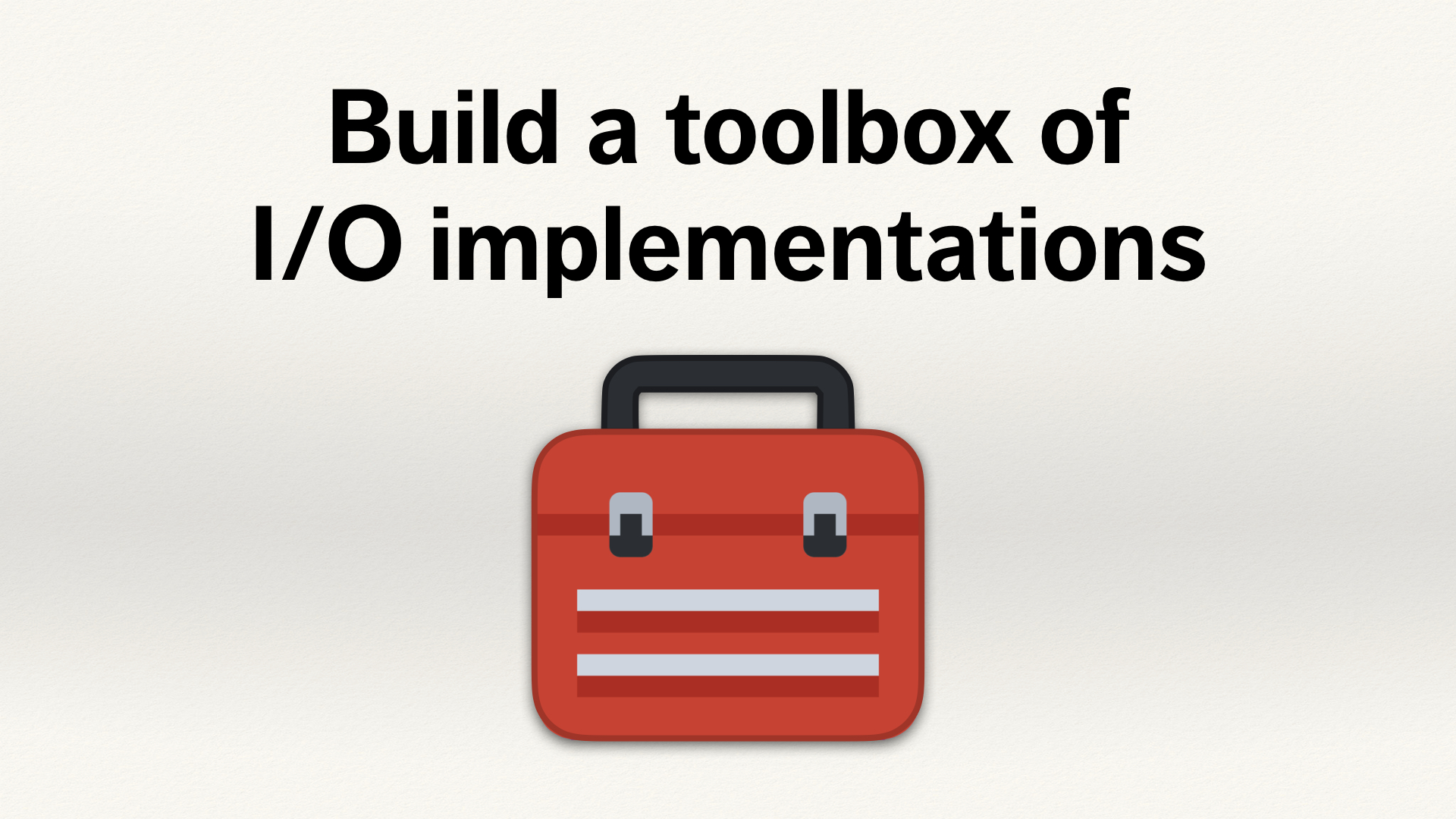 "A red toolbox, below the text ""Build a toolbox of I/O implementations""."